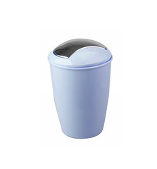 green trash bin over a white background