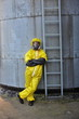 portrait of  fully protected professional at large silo