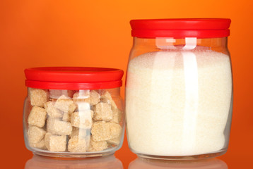 Jars with brown cane sugar lump and white crystal sugar