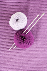 Purple sweater and a ball of wool close-up