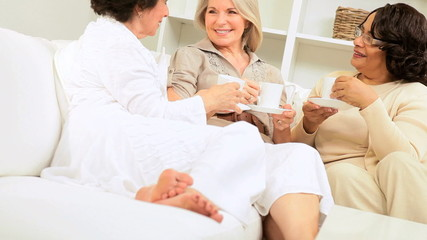 Multi Ethnic Retired Girlfriends Relaxing Home Coffee
