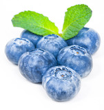 Blueberries with green leaves on a white background