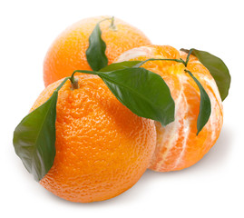 Ripe mandarin with green leaf