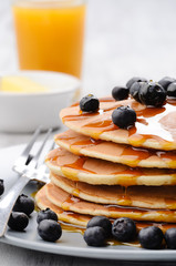 Breakfast blueberry pancakes with oj