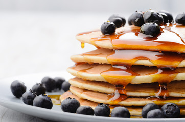 Breakfast blueberry pancakes with maple syrup