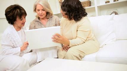 Seniors Using Laptop Computer