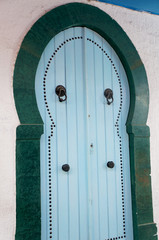 Blue door in the traditional tunisian architecture of the medina