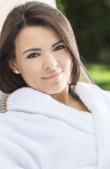 Beautiful Hispanic Woman in White Bathrobe At Health Spa