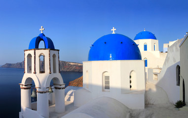 Greek orthodox church with Ferry boat in Santorini