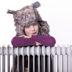 Cute girl with pelt cap likes the winter