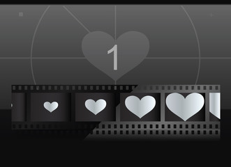 Film with heart in frames and screen on background