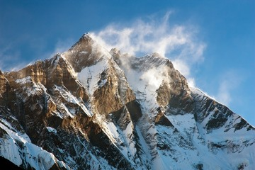 evening view of Lhotse with windstrom and snow clouds