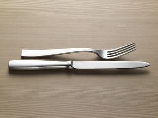 fork knife on wooden table - forchetta coltello su legno