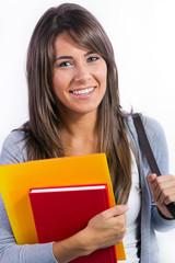 Alegre chica joven estudiante con sus libros