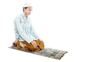 Devotional muslim man in praying