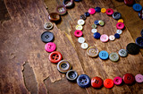 Old vintage buttons on the old wooden table