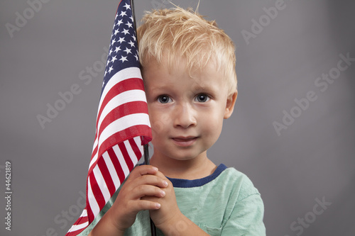 Young Boy Holds American Flag