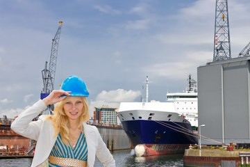 Woman engineer shipbuilder at the shipyard.