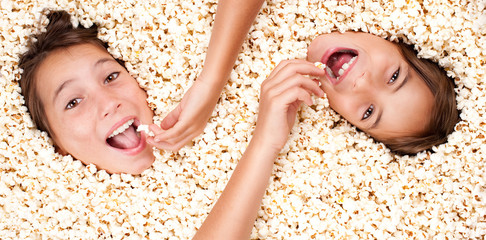two girls buried in popcorn