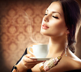 Fototapety Beautiful Woman With Cup of Coffee or Tea