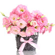 bouquet of eustoma flowers in  wicker vase, isolated on white