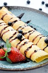 Chocolate pancakes with fruit