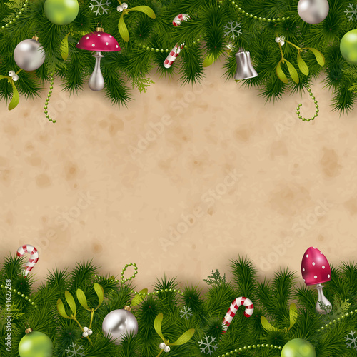 firtree border with ornaments on a stained paper background