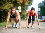 Rivalry - young couple competing in running poster