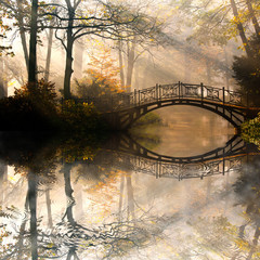 Autumn - Old bridge in autumn misty park © Gorilla