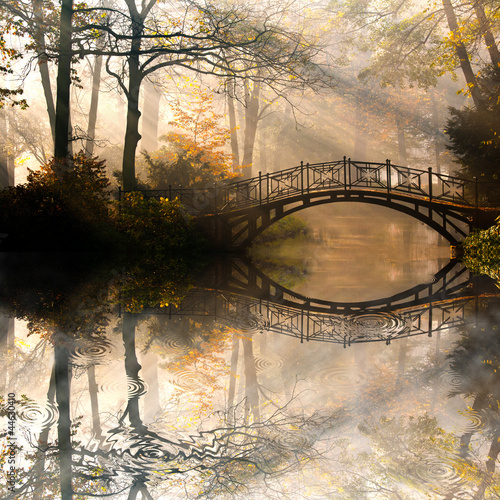 Leinwandbild Motiv Autumn - Old bridge in autumn misty park