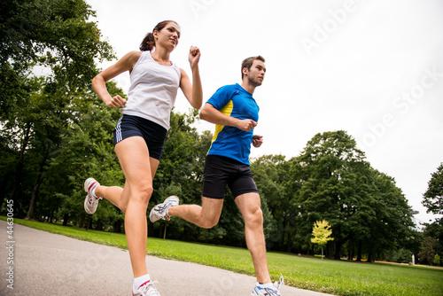 Leinwandbild Motiv Jogging together - sport young couple