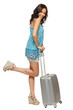 Full length of happy female standing with suitcase