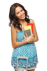 Young female in casual holding passport and tickets