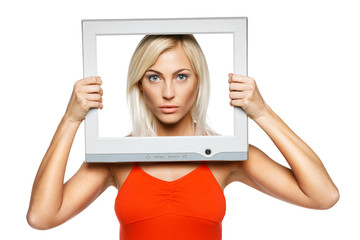 Serious female looking through TV computer screen frame