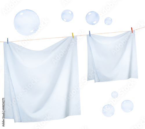 Linen sheets drying on a rope and Soap bubbles
