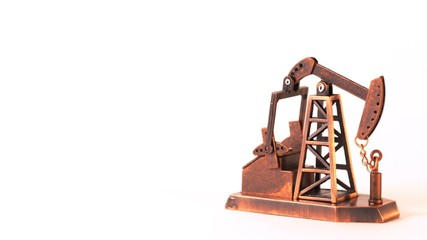 Souvenir oil pump spin clockwise about of axis on white
