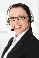 Smiling young woman with headset and microphone.