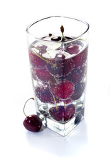 Sweet cherry in glass with water