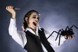 Mad vampire boy prepared to stab a spider