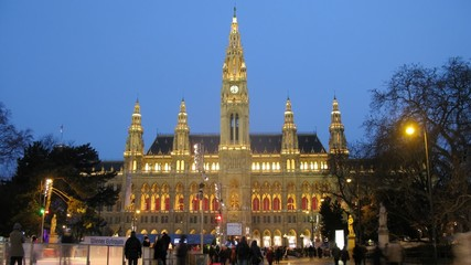 People go for drive on skating rink in front of Rathaus