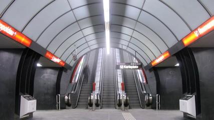 People go on escalator to subway