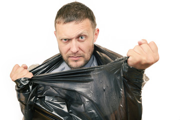 Bearded man breaks the plastic bag on white, concept, metaphor