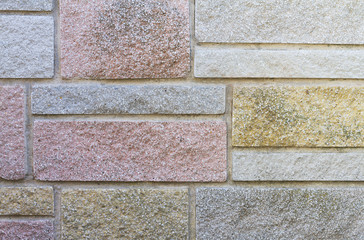 Decorative stone cladding on house wall