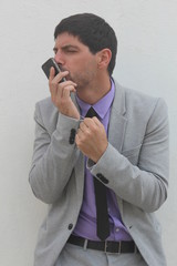 Cool businessman with his mobile phone