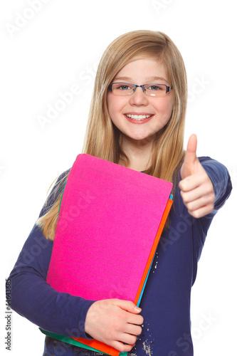 educational concept schoolgirl giving thumbs up