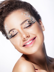 Elated young woman smiling with closed eyes - pleasure and bliss