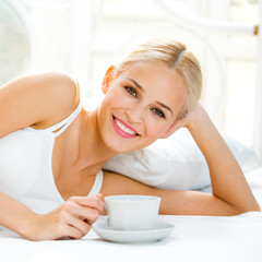 Happy smiling woman at bedroom