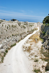 road near medieval wall, rhodos