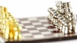 Small metalic chess figures in start position spin