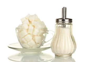 refined sugar in glass cup with sugar bowl isolated